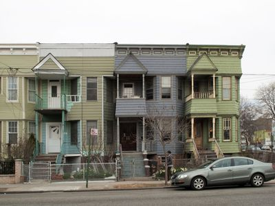 Green, Gray Rowhouses on a City Block
