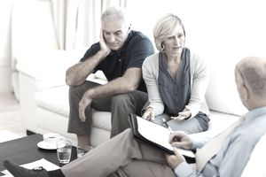 Retired couple discussing with an agent whether they still need life insurance