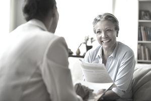 Saleswoman talking to client in living room