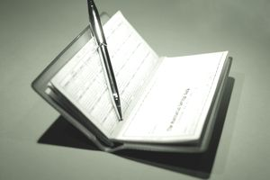 Check Book and Pen