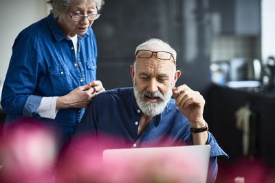 Senior couple reviews the balance in their target-date mutual fund