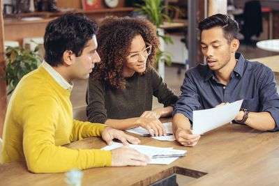 Couple reviewing investment options with a broker
