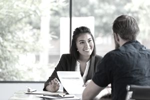 Cheerful businesswoman meets with client