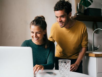 A couple looks at their rising credit scores.