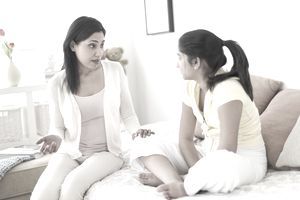 A mother talks to her daughter about finances.