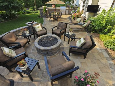 High-angle view of backyard lounge area that can be covered with homeowner's insurance
