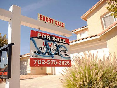 A short sale sign hangs outside a home for sale in Las Vegas, Nevada