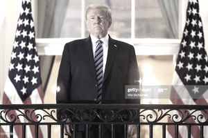 WASHINGTON, DC - OCTOBER 05: U.S. President Donald Trump stands on the Truman Balcony after returning to the White House from Walter Reed National Military Medical Center on October 05, 2020 in Washington, DC. Trump spent three days hospitalized for coronavirus. (Photo by Win McNamee/Getty Images)