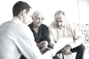 Couple discussing a living will with an estate attorney.