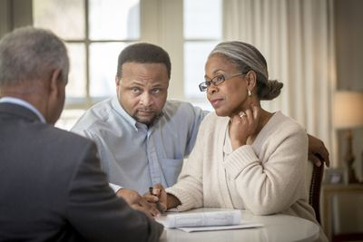 Couple talking to a loan officer
