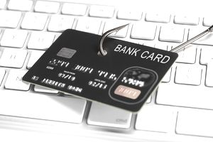 Credit card on a fish hook, representing identity theft.