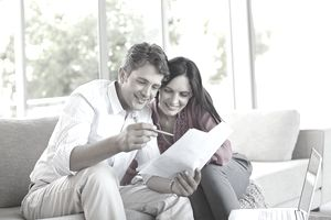 Husband and wife reviewing mortgage documents