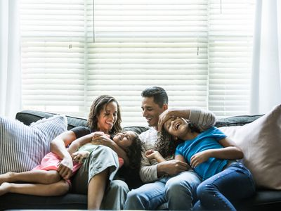 A young family enjoys their new home in a new city.