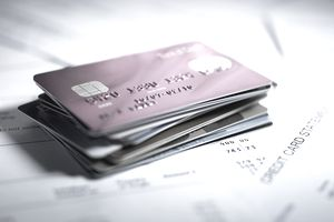 Find out what happens to your credit card debt when you die close up of stack of credit cards reheart Images