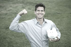 man holding piggy bank and making a muscle