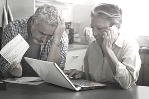 Older couple looking stressed over money