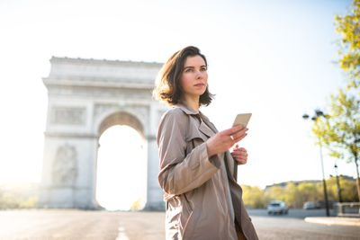 Woman text messaging in Paris
