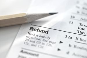 Tax return with a sharpened pencil laying by the refund area.