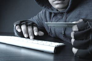 Hacker using card to steal identity