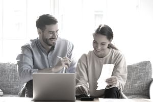 A young couple reviews their personal loan options.