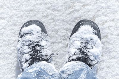 feet covered in snow, representing cold feet
