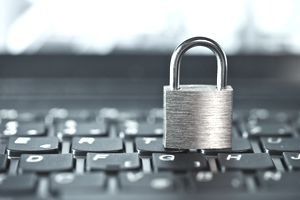 A padlock sitting on a computer keyboard indicating a secure computer.