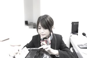 young woman in a Chinese bank setting manages Chinese currency
