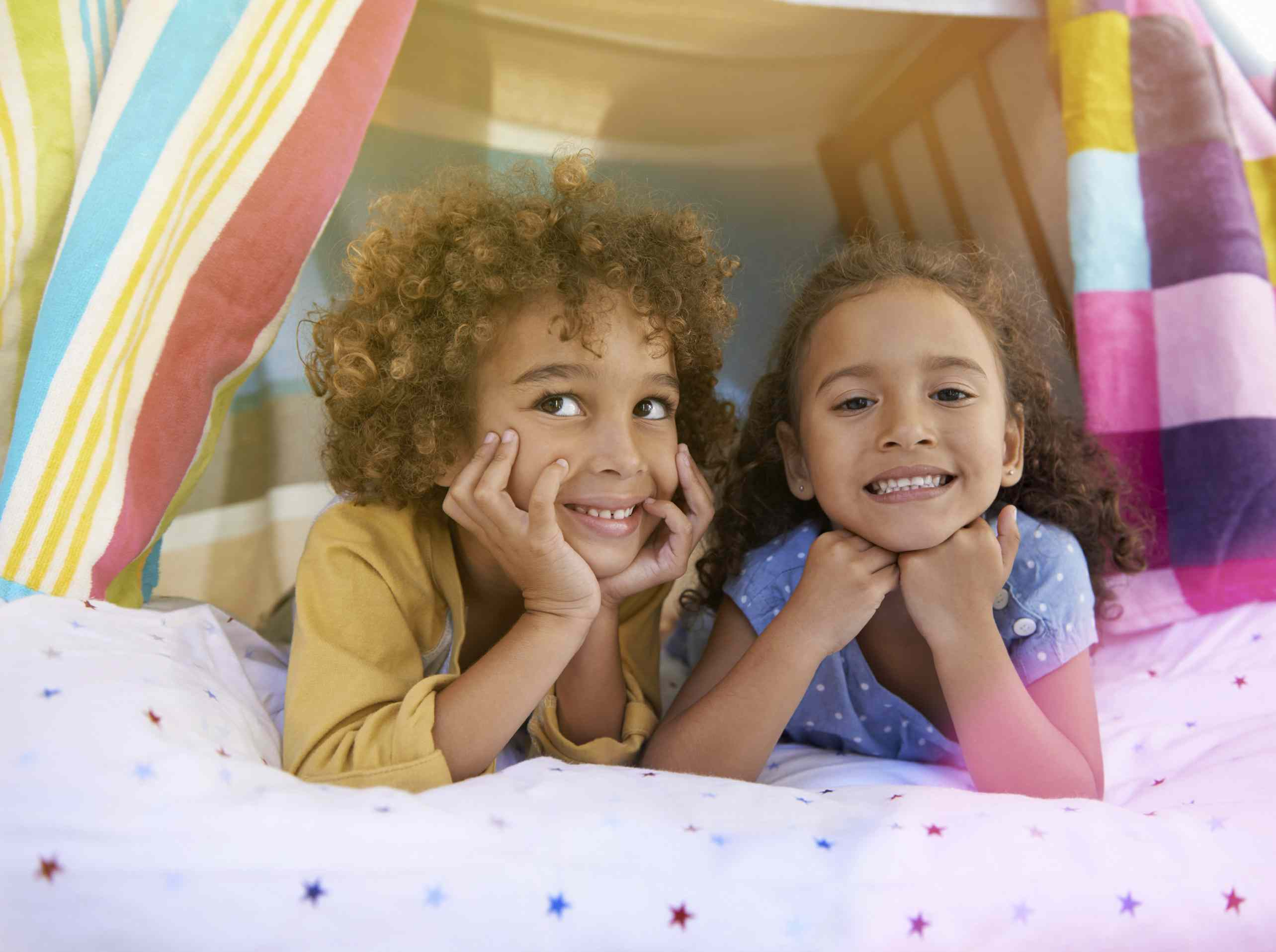 Two children playing in a fort