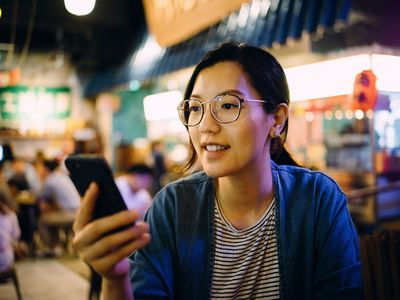 Woman connecting to neobank with smartphone