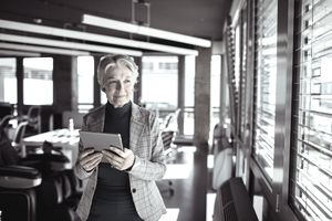 Senior businesswoman using a tablet