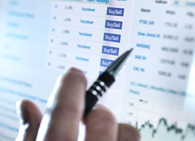 Hand of a stockbroker buying and selling shares online