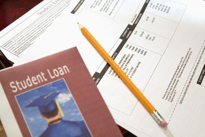 Student Loan Paperwork and Brochure with Pencil on a Table