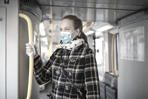 Woman with face mask travelling in metro during COVID-19 outbreak.