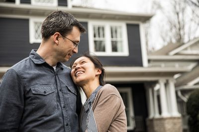 Young Couple in Front of Home