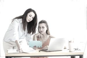 Two women discussing finance