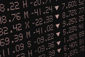 Falling Stock Prices in Red on Electronic Board