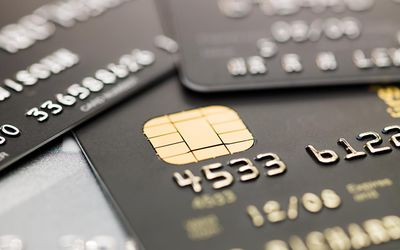 The pros and cons of a credit card balance transfer a close up of several credit cards reheart Image collections