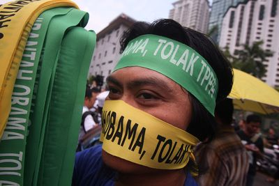 A protester wears a bandana that reads 'Reject Obama' during a protest against Trans Pacific Partnership Agreement (TPPA) outside the Global Entrepreneurship Summit on October 11, 2013 in Kuala Lumpur, Malaysia.