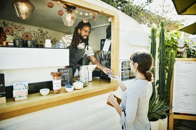 Food truck owner taking credit card payment from customer