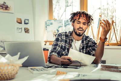 young creative artists feeling fed up while working