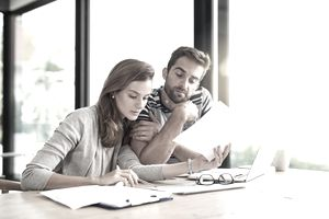 A young couple working on their household budget and paying bills online