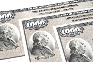 A closeup of three $1,000 U.S. savings bonds