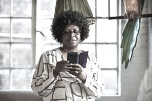 Portrait of mature woman using smartphone at home