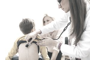 pediatrician examining young boy