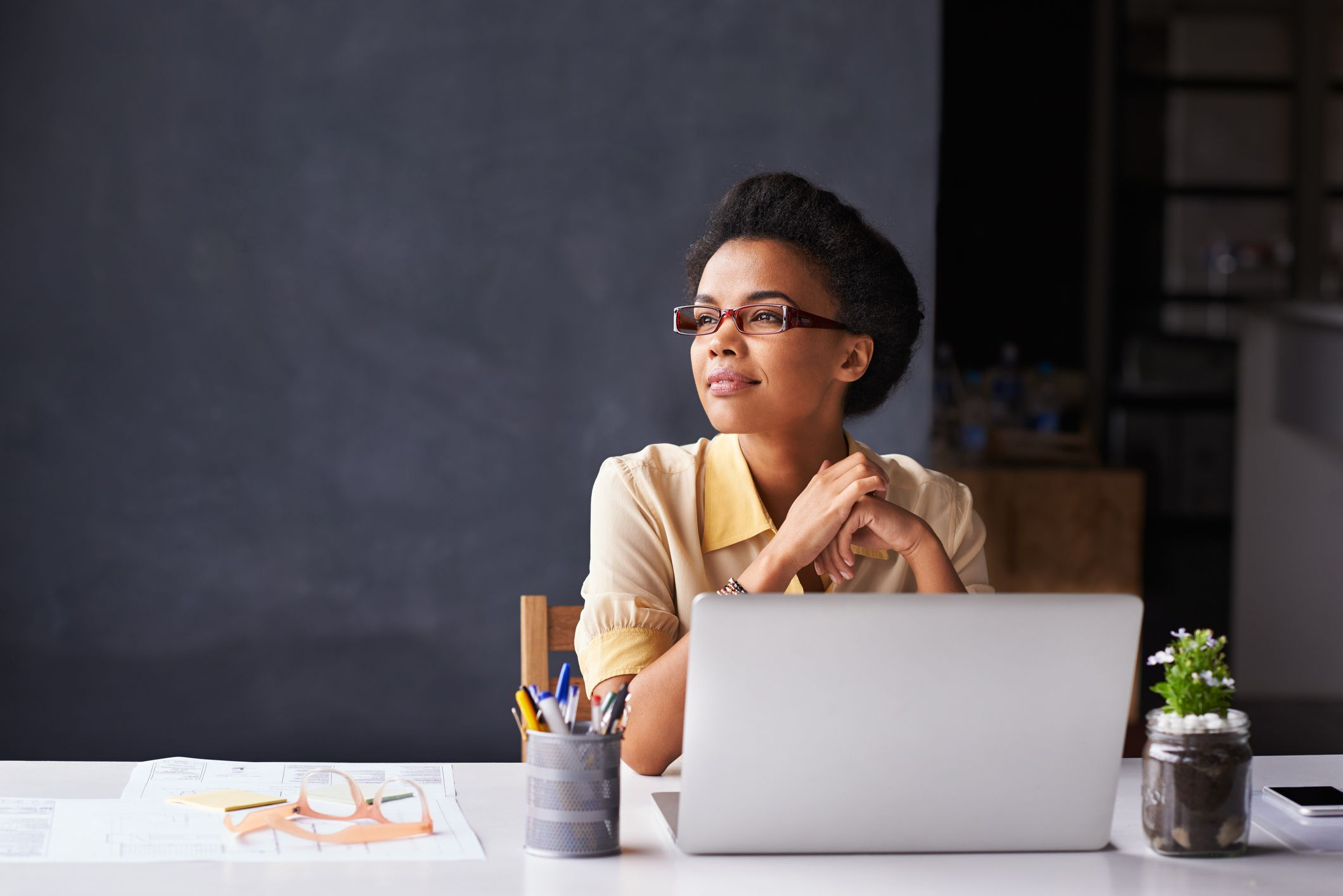 Woman looking out window in office