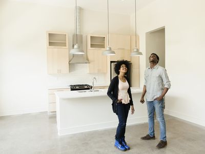 Man and woman in home wondering what kind of insurance they need