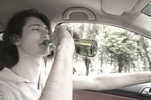 Man Driving Car While Drinking Beer