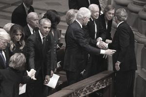 Former U.S. President George W. Bush (R) greets fellow former presidents Jimmy Carter, Bill Clinton and Barack Obama during the state funeral for his father, former President George H.W. Bush