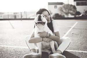 Young woman hugs her dog