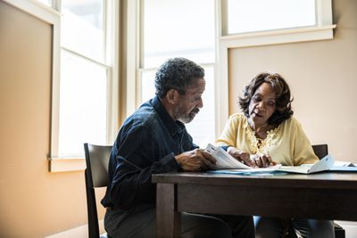 Couple discussing their investments for retirement